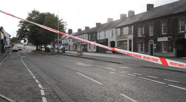 The scene in Moira on Saturday where a woman was fatally struck by a car. Pic Pacemaker