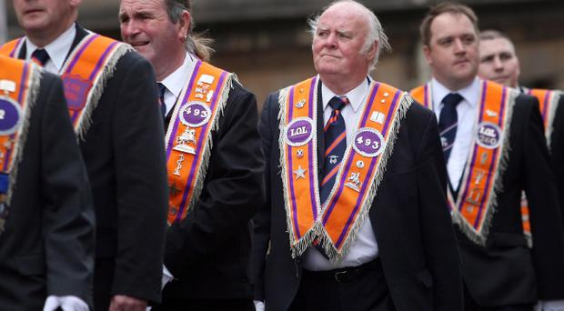 An Orange Order parade through the streets of Glasgow in 2010. Pic David Cheskin/PA