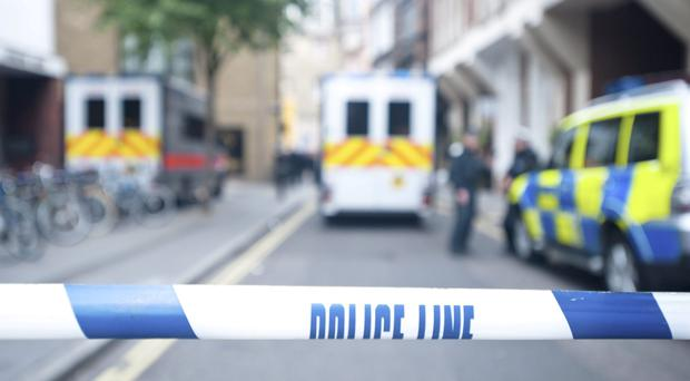 A young couple on their way home were confronted by a gang brandishing hammers, police have said