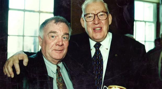 Eddie McIlwaine with Rev Ian Paisley in Belfast City Hall back in 1999 where they sang alongside California gospel choir, The Southern Airs