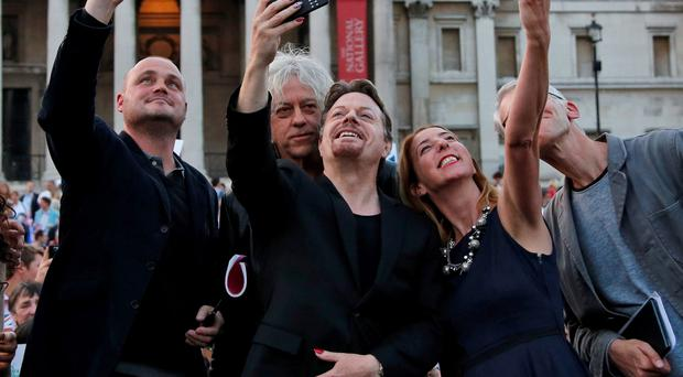 Al Murray, Bob Geldof, Eddie Izzard, and Victoria Coren take pictures of themselves during a pro-Union rally at Trafalgar Square in London yesterday