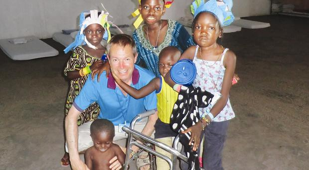 Thank you: Michael McBrien with some of the many children helped by the team