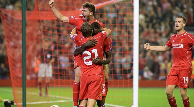 Liverpool's Mario Balotelli celebrates scoring their first goal of the game with team-mates Leiva Lucas and Fabio Borini (centre) during the UEFA Champions League, Group B match at Anfield, Liverpool