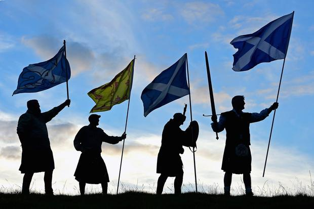 Duncan Thomson, Brian McCutcheon, John Patterson and Arthur Murdoch,from King of Scots Robert the Bruce Society, hold the Scottish flags as they prepare to vote in the Scottish independence referendum on September 14, 2014 in Loch Lomond. (Photo by Jeff J Mitchell/Getty Images)