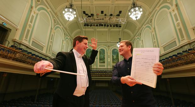 Conductor Eugene Monteith, from Strabane, pictured with Ciaran Scullion, Head of Music, Arts Council of Northern Ireland. Pic Picture John Murphy/Aurora PA