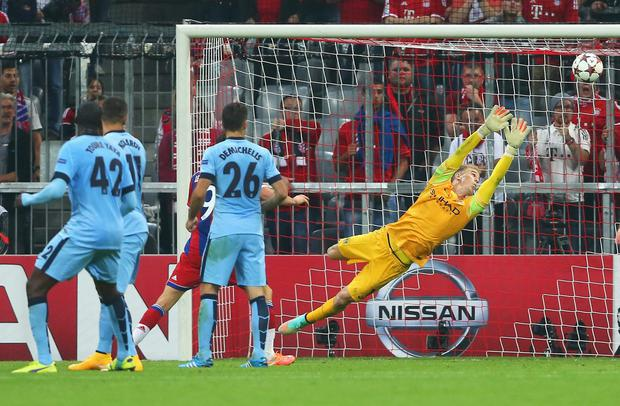 Joe Hart of Manchester City fails to stop the shot by Jerome Boateng of Bayern Muenchen (not in picture) for the opening goal during the UEFA Champions League Group E match between Bayern Munchen and Manchester City at the Allianz Arena on September 17, 2014 in Munich, Germany. (Photo by Alexander Hassenstein/Bongarts/Getty Images)