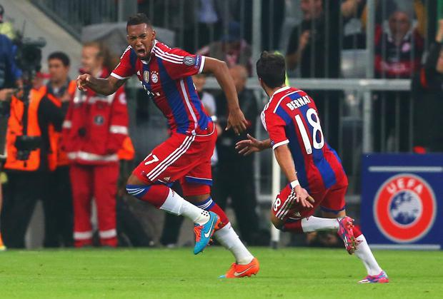 Jerome Boateng of Bayern Muenchen celebrates his goal with Juan Bernat of Bayern Muenchen during the UEFA Champions League Group E match between Bayern Munchen and Manchester City at the Allianz Arena on September 17, 2014 in Munich, Germany. (Photo by Alexander Hassenstein/Bongarts/Getty Images)