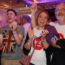 Better Together campaigners celebrate early poll results at a party on September 19, 2014 in Glasgow, Scotland. (Photo by Peter Macdiarmid/Getty Images)