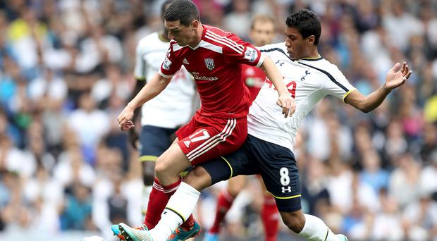 Tottenham Hotspur's Paulinho (right) and West Browmich Albion's Graham Dorrans battle for the ball during during the Barclays Premier League match at White Hart Lane, London. Phil Cole/PA Wire.