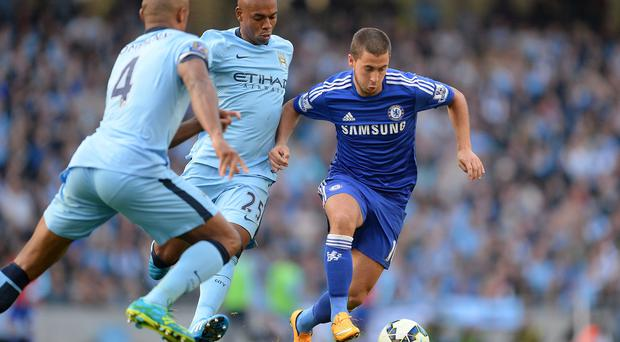 Chelsea's Eden Hazard (right) and Manchester City's Fernandinho battle for the ball during the Barclays Premier League match at the Etihad Stadium, Manchester. Martin Rickett/PA Wire.