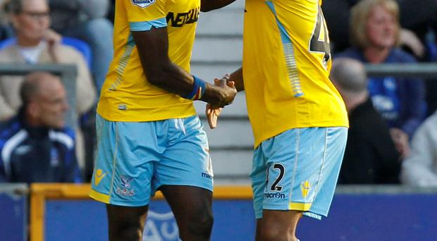 Crystal Palace's Yannick Bolasie (left) celebrates scoring his sides second goal of the game with team-mate Crystal Palace's Jason Puncheon during the Barclays Premier League match at Goodison Park, Liverpool. Peter Byrne/PA Wire.