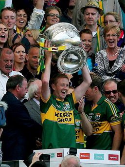 Legend: Kerry's Colm 'Gooch' Cooper lifts the Sam Maguire trophy