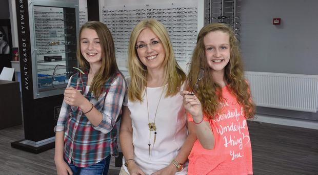 See here: Alex (left) and Abbey with optician Gillian Gervais