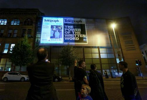 Culture Night in Belfast and the Belfast Telegraph front page projections. Pic Kevin Scott / Belfast Telegraph