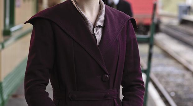 Guilty pleasure: Lady Mary, played by Michelle Dockery, enjoys a privileged life in the hit TV series