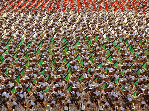 Members of the Iran's Revolutionary Guard march during an annual military parade marking the 34th anniversary of outset of the 1980-88 Iran-Iraq war, in front of the mausoleum of the late revolutionary founder Ayatollah Khomeini just outside Tehran, Iran, Monday, Sept. 22, 2014. (AP Photo/Ebrahim Noroozi)