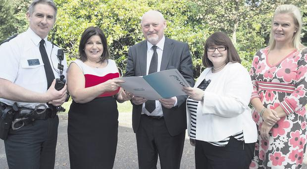 At the launch of a criminal justice strategy were PSNI inspector Jonny Hunter; Foyle Women's Aid director Marie Brown, District Judge Barney McElholm, Victim Support policy manager Gillian Clifford and 24hr Domestic and Sexual Violence Helpline manager Sonya McMullan