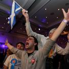 Better Together supporters celebrate in Glasgow as Scotland rejected independence. Pic Lynne Cameron/PA Wire