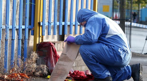 Police forensics at the scene on the Springfield Road in West Belfast. Pic Colm Lenaghan/Pacemaker