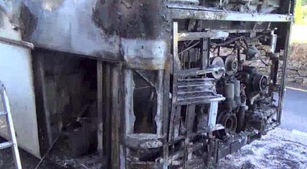 A bus headed to the National Ploughing Championships was severely damaged after it caught fire