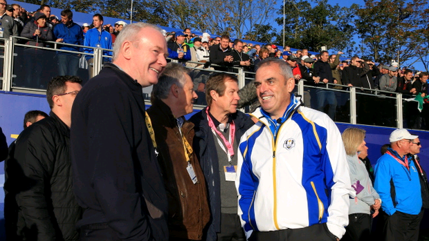Peter Robinson and Martin McGuinness talk to Europe team captain Paul McGinley during the Morning Fourballs of the 2014 Ryder Cup at Gleneagles.