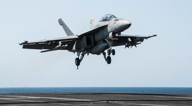 An F/A-18F Super Hornet, attached to the