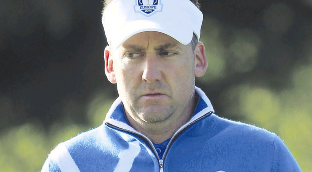 Deep in thought: Ian Poulter looks pensive during his defeat in the fourballs yesterday morning