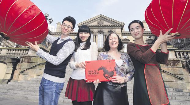 Changxu Chen, Chinese language assistant at Rathmore Grammar School; Zhu Wenting, Chinese language assistant, Carr's Glen Primary School; Isabelle Martin, project delivery officer for the Language Assistant Programme, British Council Northern Ireland, and Zhang Haiyang, Chinese language assistant, St Joseph's Primary School