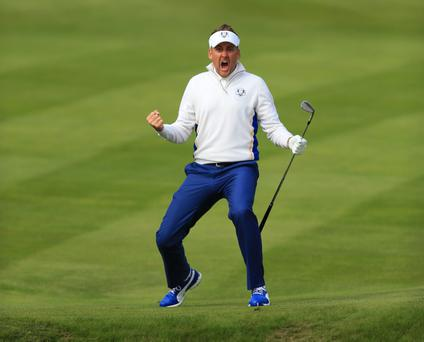 Europe's Ian Poulter celebrates chipping in off the green during day two of the 40th Ryder Cup at Gleneagles Golf Course, Perthshire.