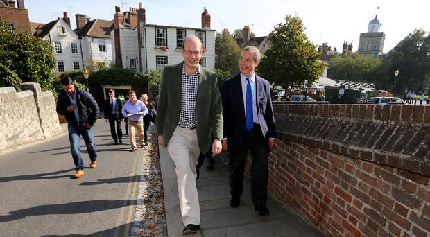 Tory defector Mark Reckless (left) and Ukip leader Nigel Farage walk through Rochester in Kent, as Reckless has rejected charges he acted in bad faith in leaving the party and switching to Ukip. Gareth Fuller/PA Wire.
