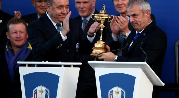 Scotland first Minister Alex Salmond (left) presents Europe captain Paul McGinley with the Ryder Cup during the presentations on day three of the 40th Ryder Cup at Gleneagles Golf Course, Perthshire. Andrew Milligan/PA Wire.