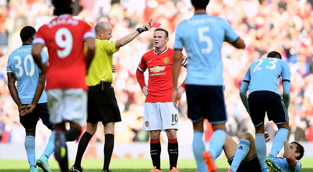 Seeing red: Wayne Rooney is sent off after his reckless challenge on West Ham United's Stuart Downing