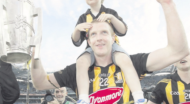 Cup of cheer: Kilkenny's Henry Shefflin celebrates his 10th All-Ireland win with his son Henry jnr