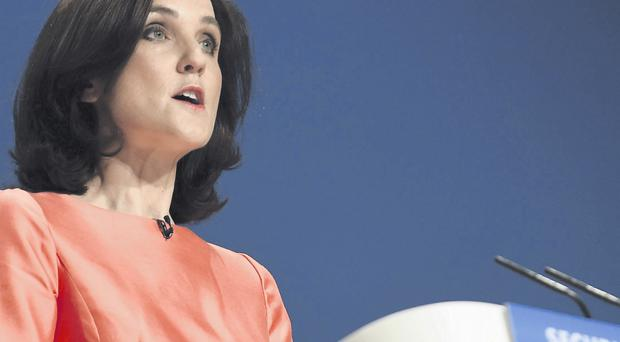 Secretary of State Theresa Villiers addresses the Conservative conference yesterday