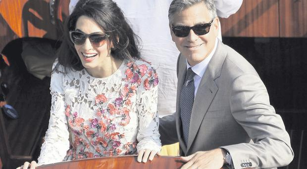 George Clooney and Amal Alamuddin after their wedding in Venice yesterday