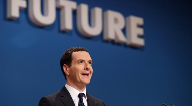 Chancellor of the Exchequer George Osborne addresses the Conservative party conference on September 29, 2014 in Birmingham, England.