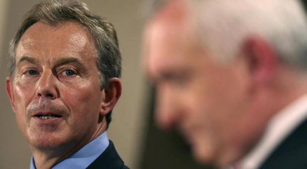 British Prime Minister Tony Blair and Irish Prime Minister Bertie Ahern during a news conference after talks aimed at re-establishing devolution to Northern Ireland at St Andrews, Scotland. Friday October 13, 2006.