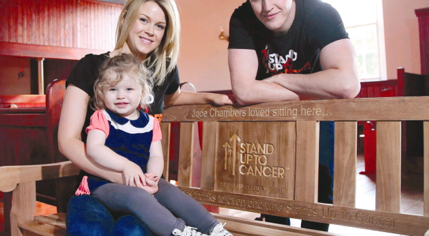 Happy family: Jade Chambers with her husband Paul and daughter Lily on the bench which bears her name at the Ulster Folk and Transport Museum