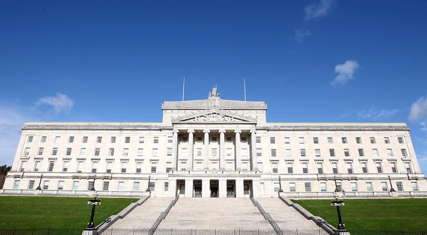 The Stormont Executive is facing legal action over an alleged failure to develop an anti-poverty strategy for Northern Ireland