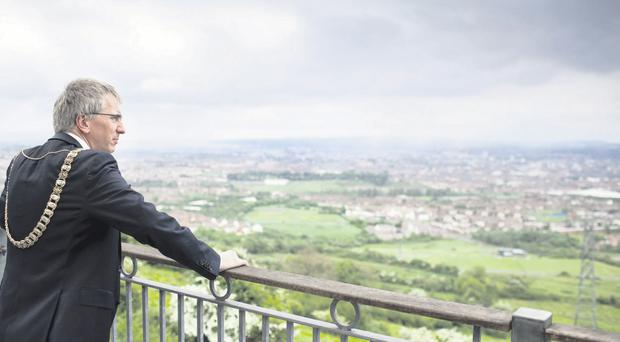 Mairtin O Muilleoir looks out over Belfast on his last day as Lord Mayor