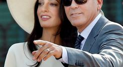 George Clooney and his bride Amal Alamuddin
