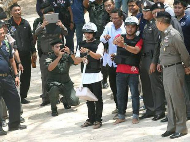 Two Myanmar migrant workers suspected of killing two British tourists participate in a crime re-enactment
