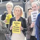 Bloody Sunday victims' families attend a protest rally at Derry's Guildhall Square on Saturday