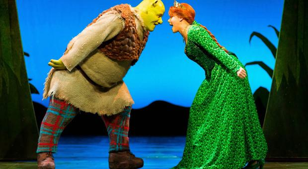Dean Chisnall as Shrek and Faye Brookes as Princess Fiona on stage at Belfast's Grand Opera House