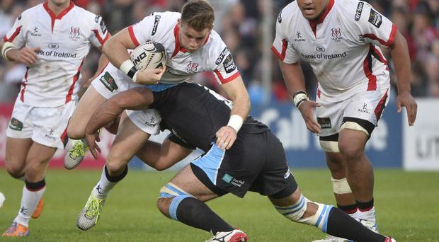 Ulster's Craig Gilroy in action with Glasgow's Josh Strauss. Pic Stephen Hamilton/Presseye