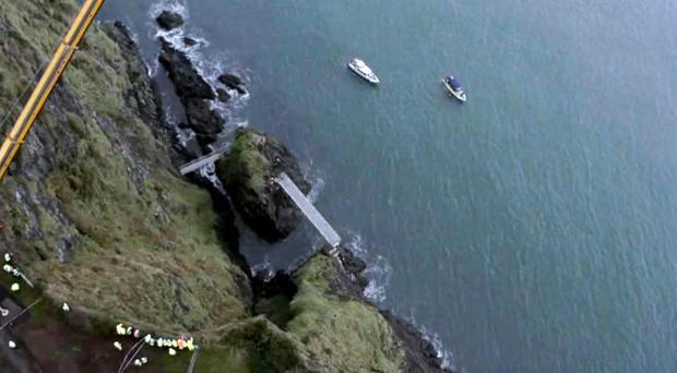 Stunning drone footage shows tubular bridge section of the Gobbins coastal path lifted into place