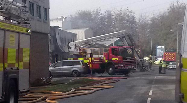 Firefighters at the scene of the blaze at the fireworks warehouse in Stafford yesterday