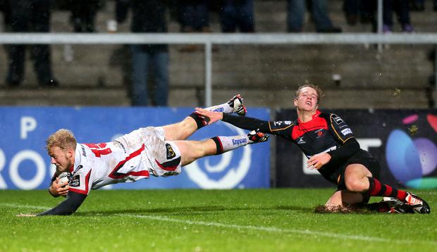 Stuart Olding scores for Ulster, challenged by by the Dragons Angus O'Brien. Darren Kidd / Press Eye.