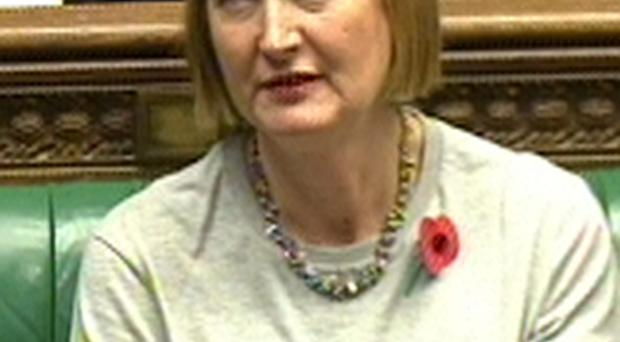 Deputy leader of the Labour party Harriet Harman wears a feminist T-shirt during Prime Minister's Questions in the House of Commons, London. PA/PA Wire.