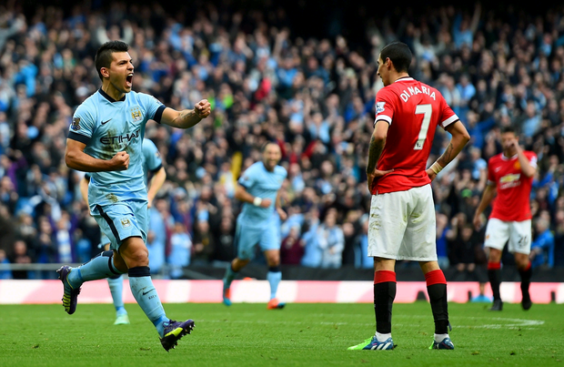 Blue heaven : City matchwinner Sergio Aguero adds to the derby despair for United's Di Maria